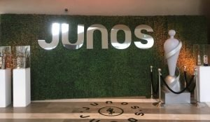 Photo backdrop and step and repeat photo opportunity for the Junos. Boxwood Hedge backing with custom logo letters