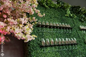 Self Serve Champagne wall with cherry blossom tree, added greenery accent and champagne flutes in holder