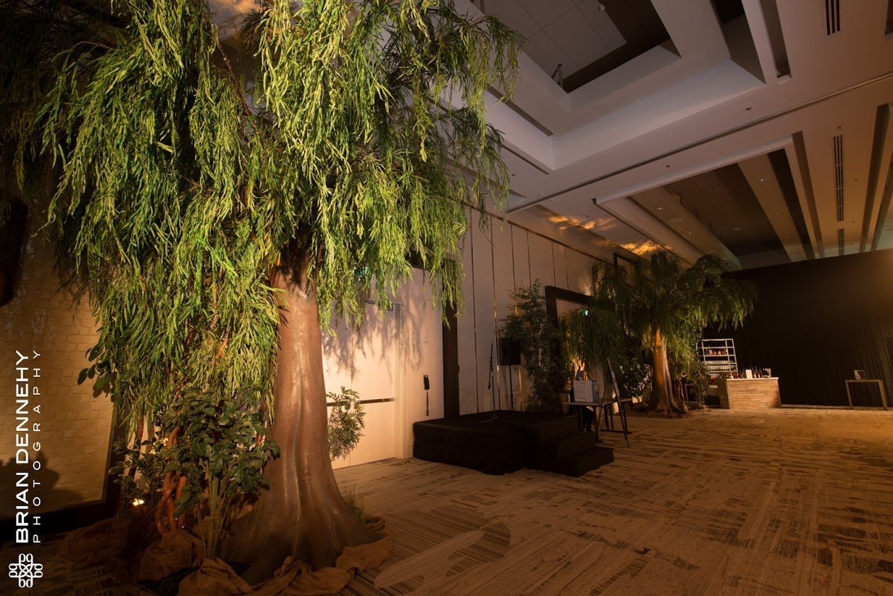 Large canopy willow trees on foam trunks for wizard of oz themed event