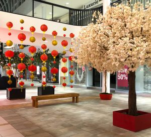 Chinese New Year decor with 12' cherry blossom canopy tree and lanterns