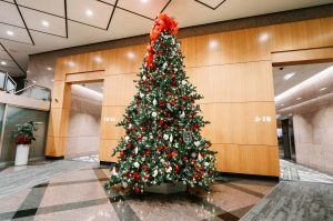 commercial christmas tree in office building lobby with red, white and silver decor, 16' tall