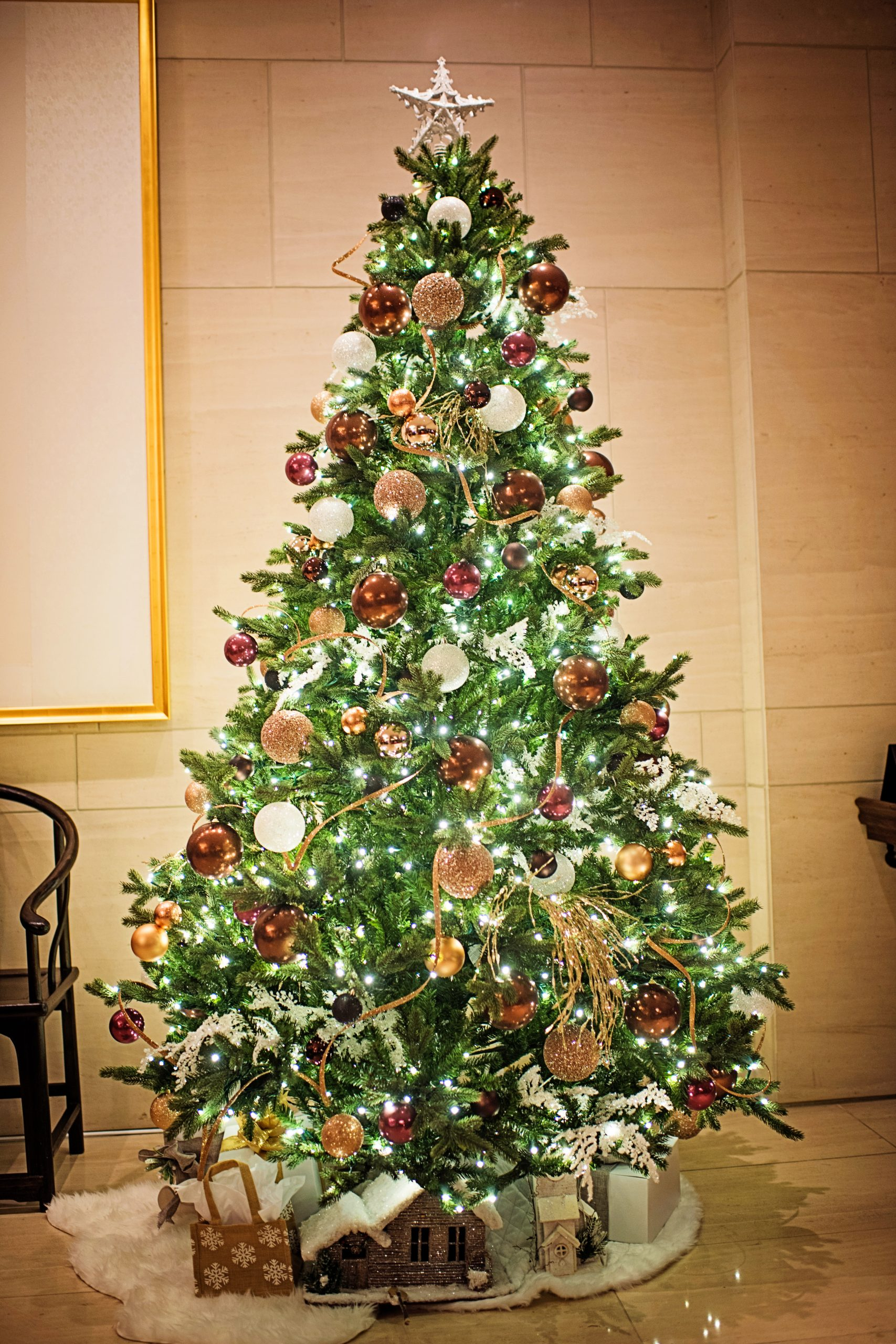 commercial christmas tree in hotel lobby with west coast gilded theme decor