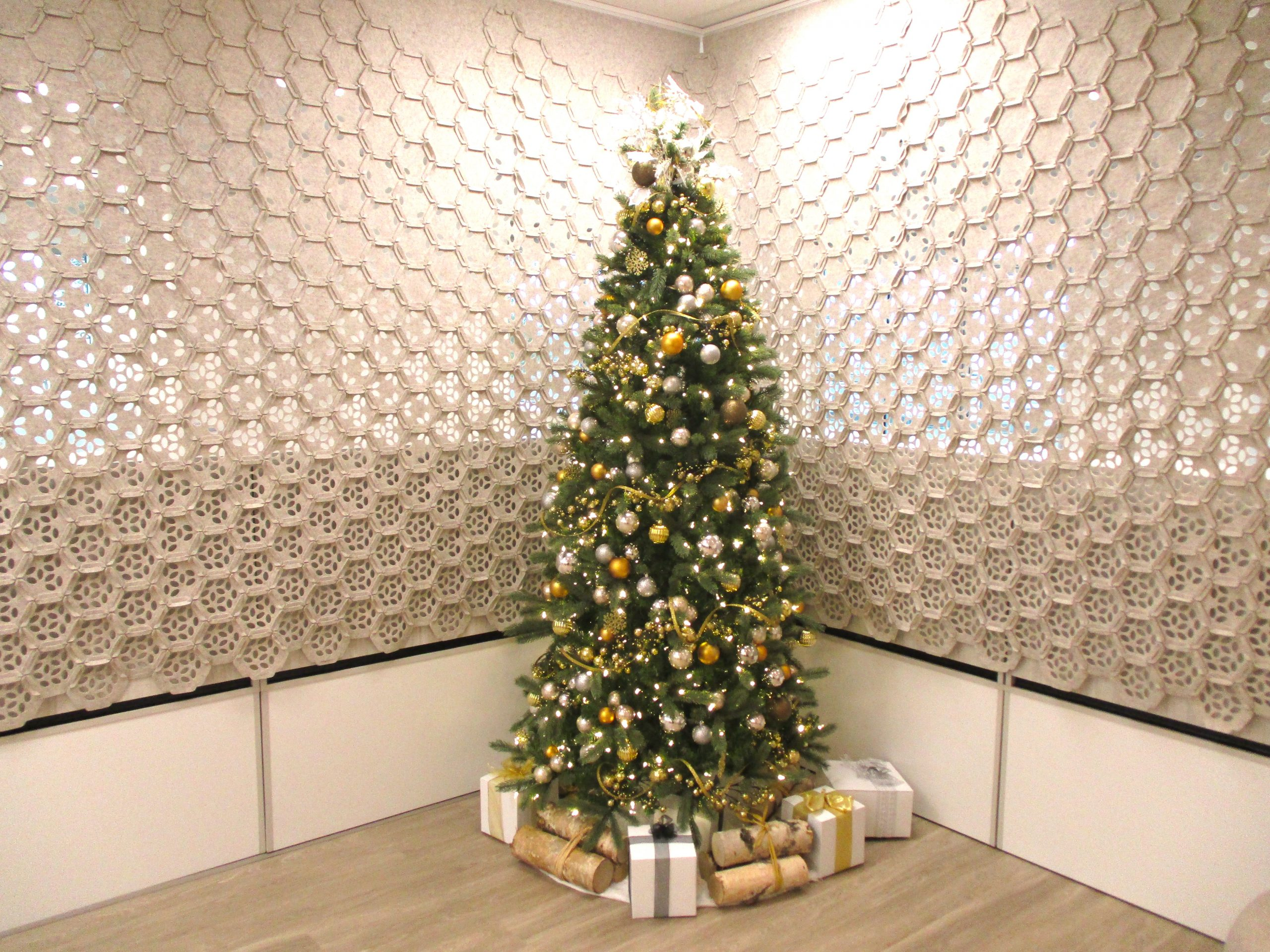 commercial christmas tree with mixed metal decor in office lobby