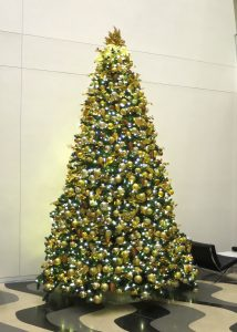 commercial christmas tree, 16 feet tall, decorated in bronze gold and copper decor