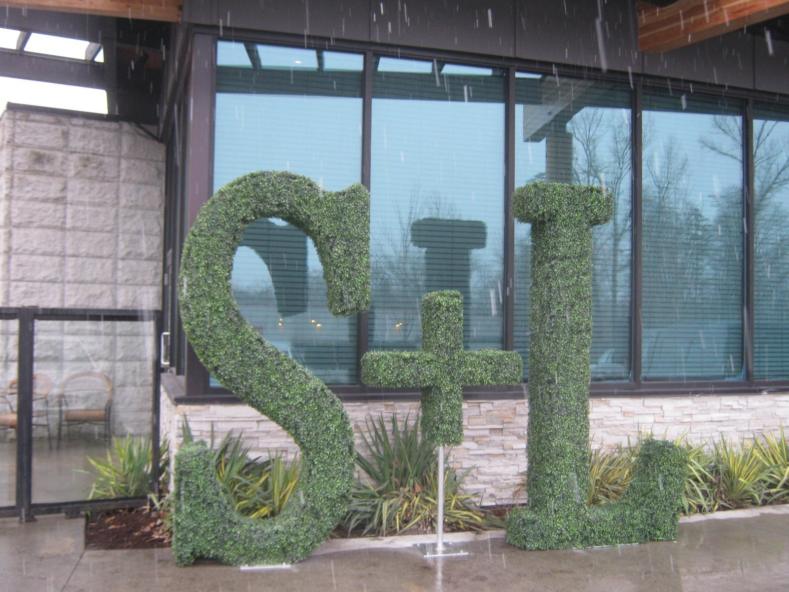 Custom built logo and letters made of boxwood