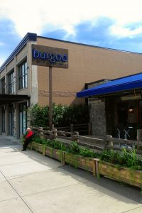 Burgoo restaurant patio decor featuring artificial grasses, bamboo and mixed greenery in cedar planters