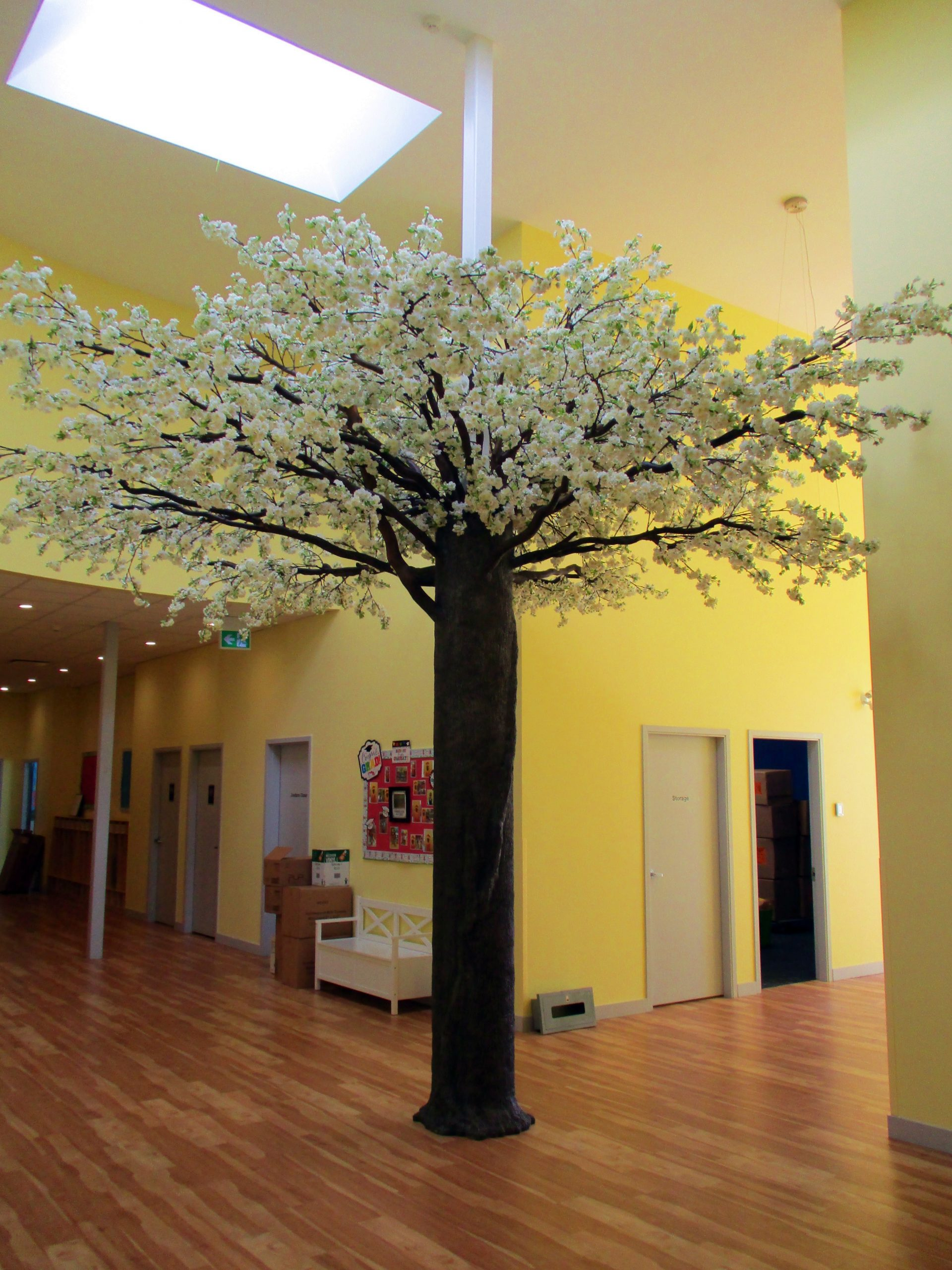 Cherry Blossom Tree as pillar surround in CEFA childcare facility, sculpted epoxy trunk. artificial white cherry blossoms