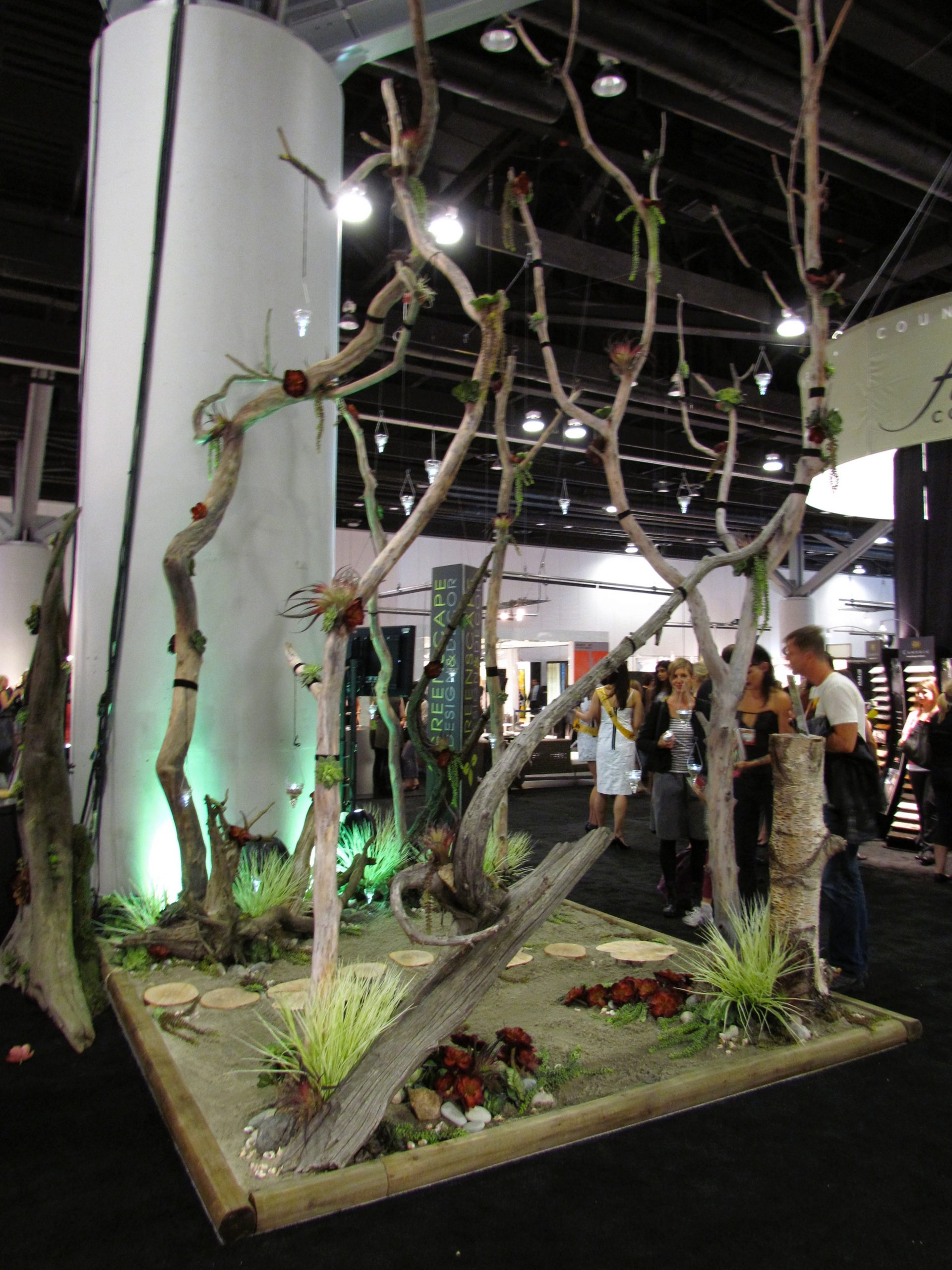 Driftwood sculpture with artificial grass and sand pit for IDS tradeshow