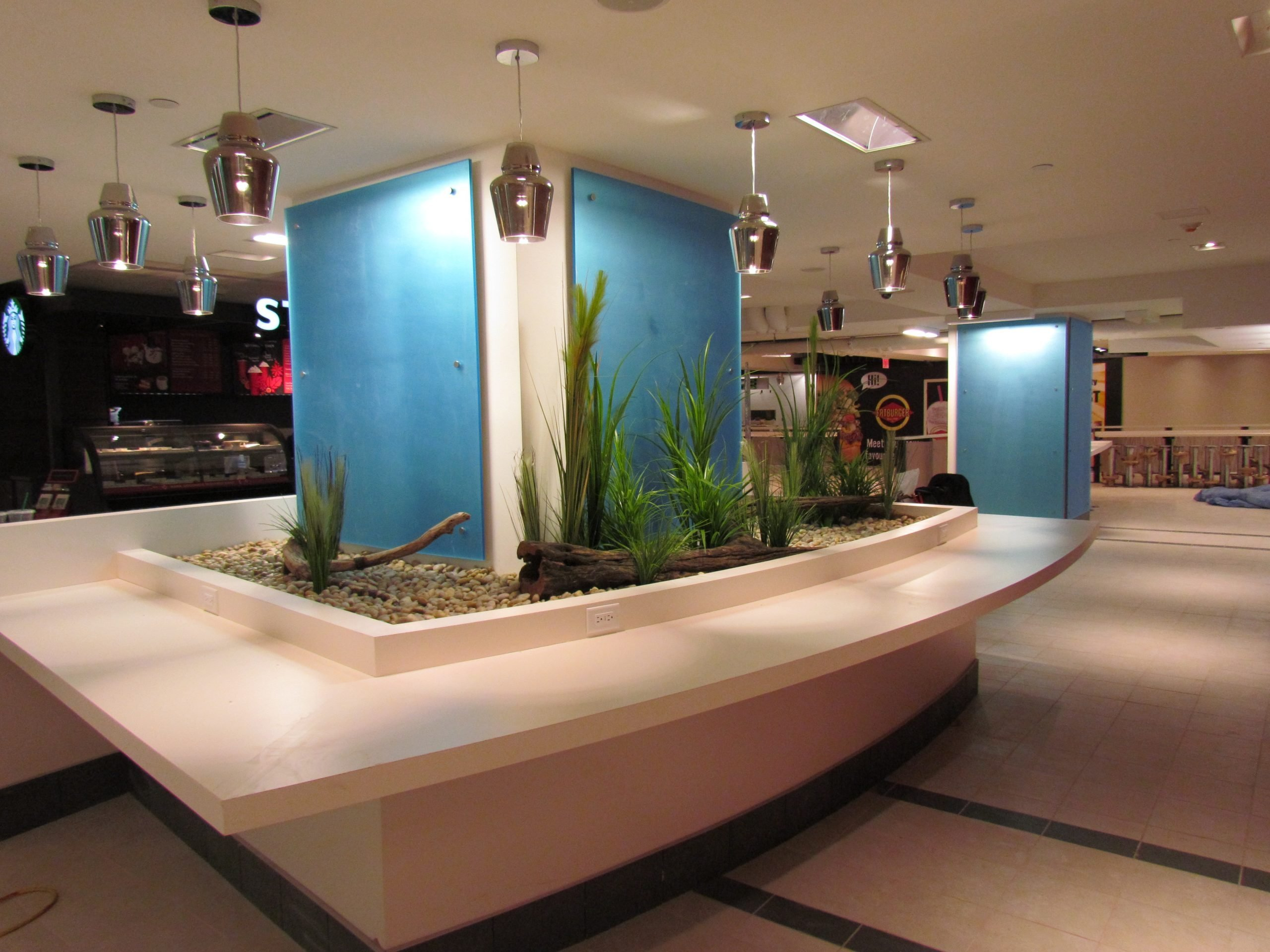 Custom driftwood and grass display in Harbour Centre food court