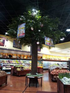 Thirty foot tall oak tree on sculpted epoxy trunk in grocery store display