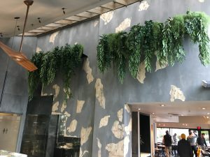 Custom hanging greenery treatment for shelving, fire retardant in commercial restaurant