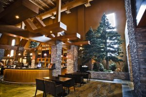 Large scale artificial evergreen trees in onsite millwork at Saw Ridge Edmonton
