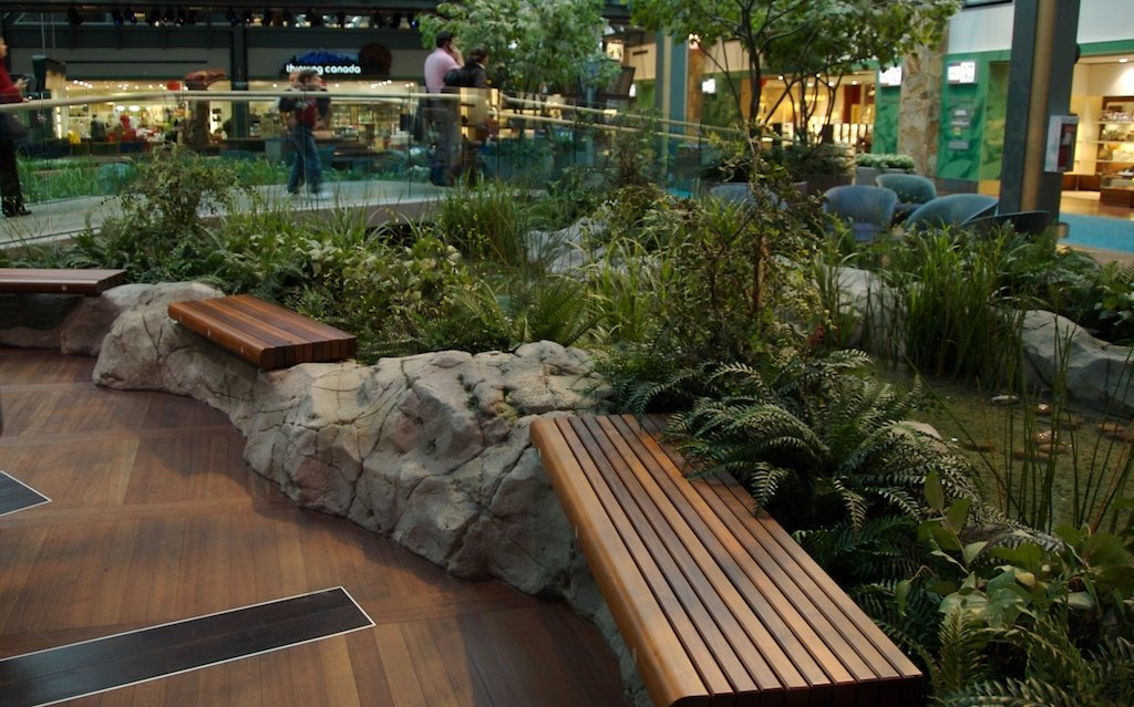 Full custom artificial landscape feature at YVR airport creekside, international departures