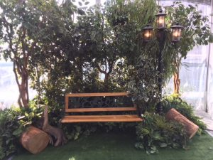 West Coast tree vignette with added park bench and lamp post for park themed event decor