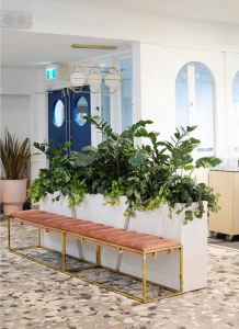 Metal planters by client, filled with artificial tropical plant mix including zamia and philodendron at The Loft