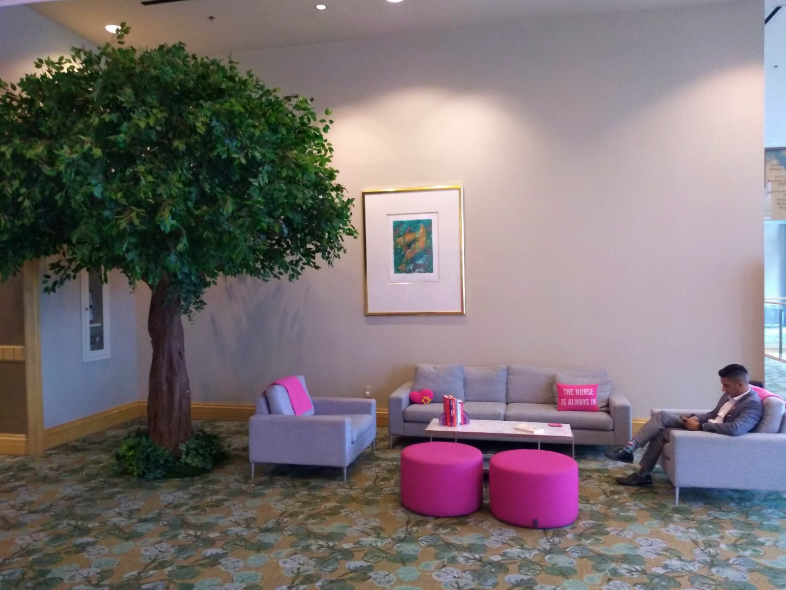 Canopy Ficus tree in grey and pink accented lounge for branded event decor