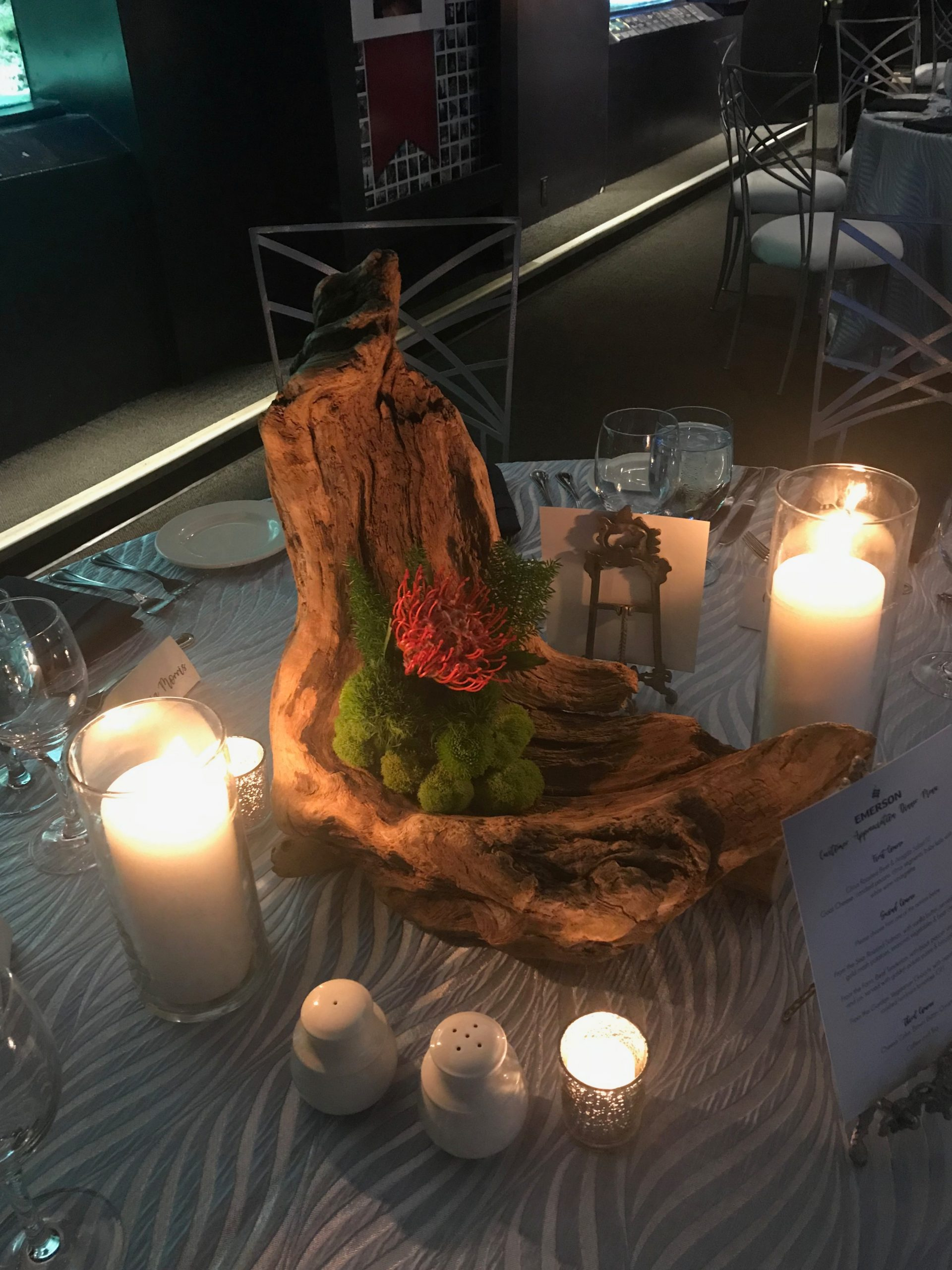 Driftwood centrepiece with bud holders for individual flower stems and preserved moss accent