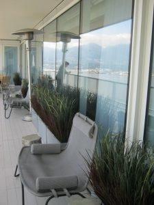 Residential condo patio with rectangular grass planters