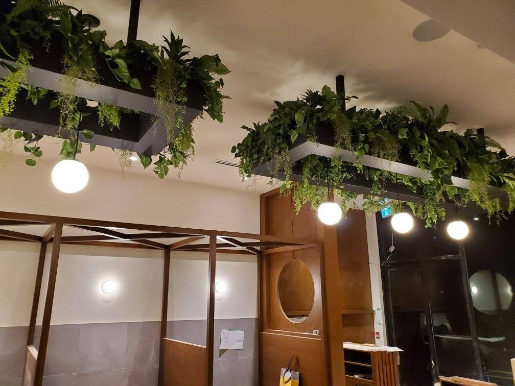 Artificial hanging greenery, custom built for light fixture surround, fire retardant