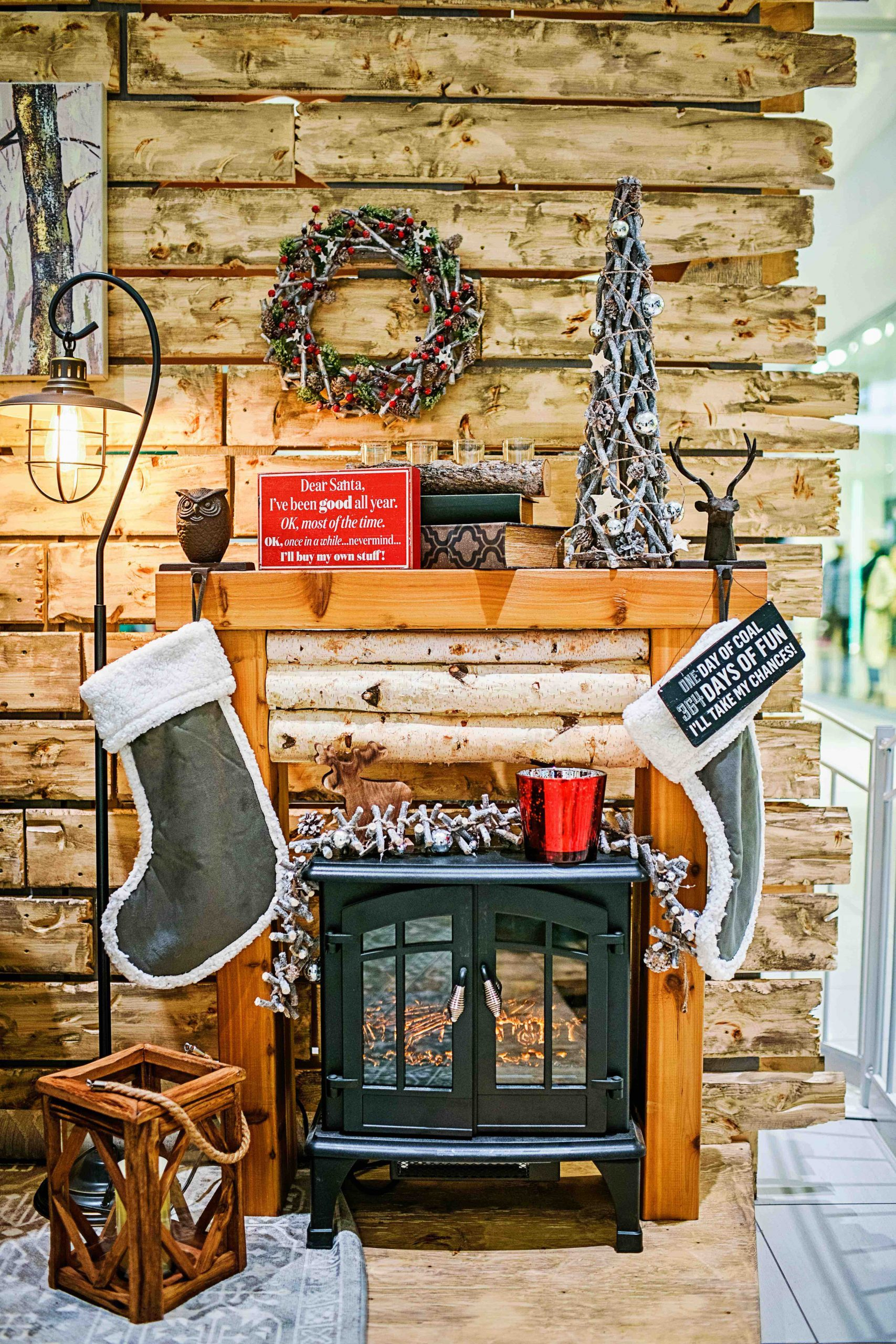 Rustic santa set with reclaimed wood backing, custom birch fireplace surround and holiday accents
