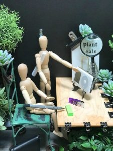 close up shot of mini collage of office setting with greenery added