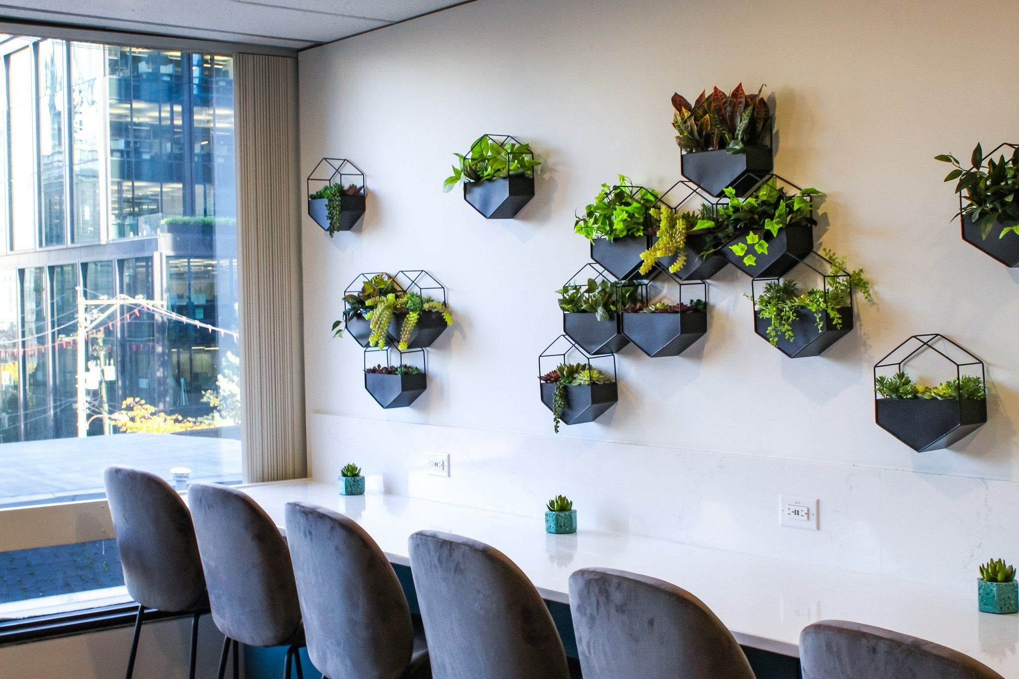 Black hexagon wall planters filled with various artificial greenery for office building kitchen wall decor
