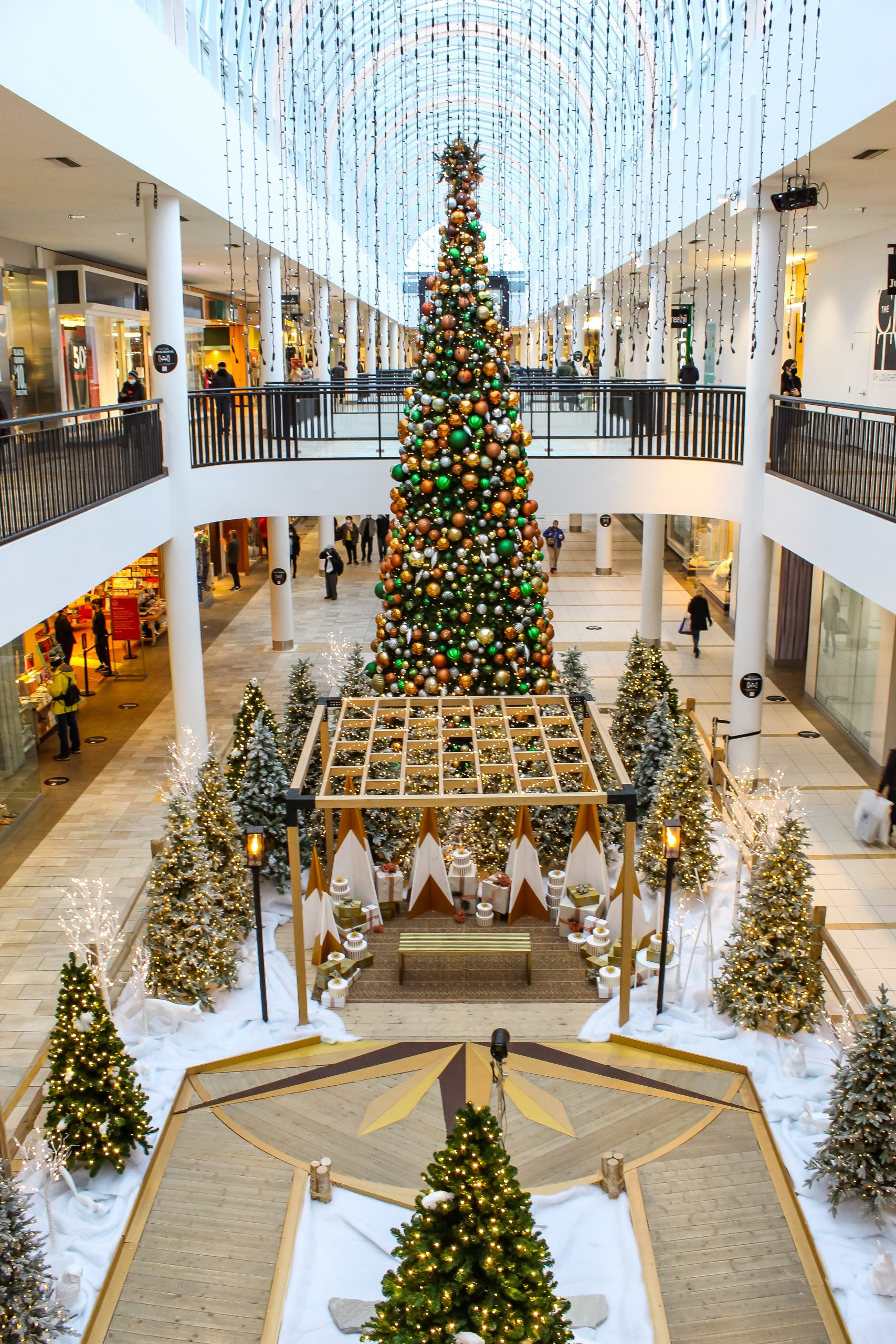 wide shot of gold and white holiday santa set turned into distanced walk through experience