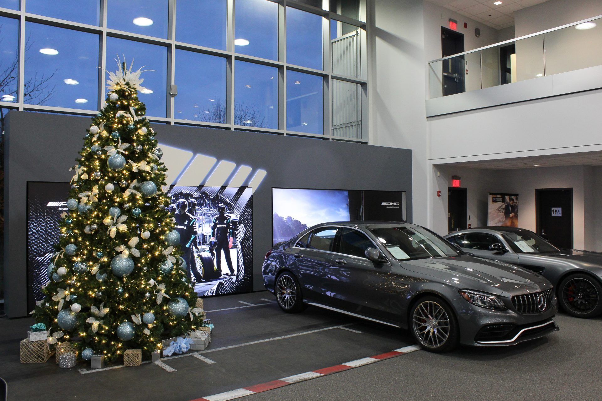 white, silver and icy blue christmas tree inside car dealership