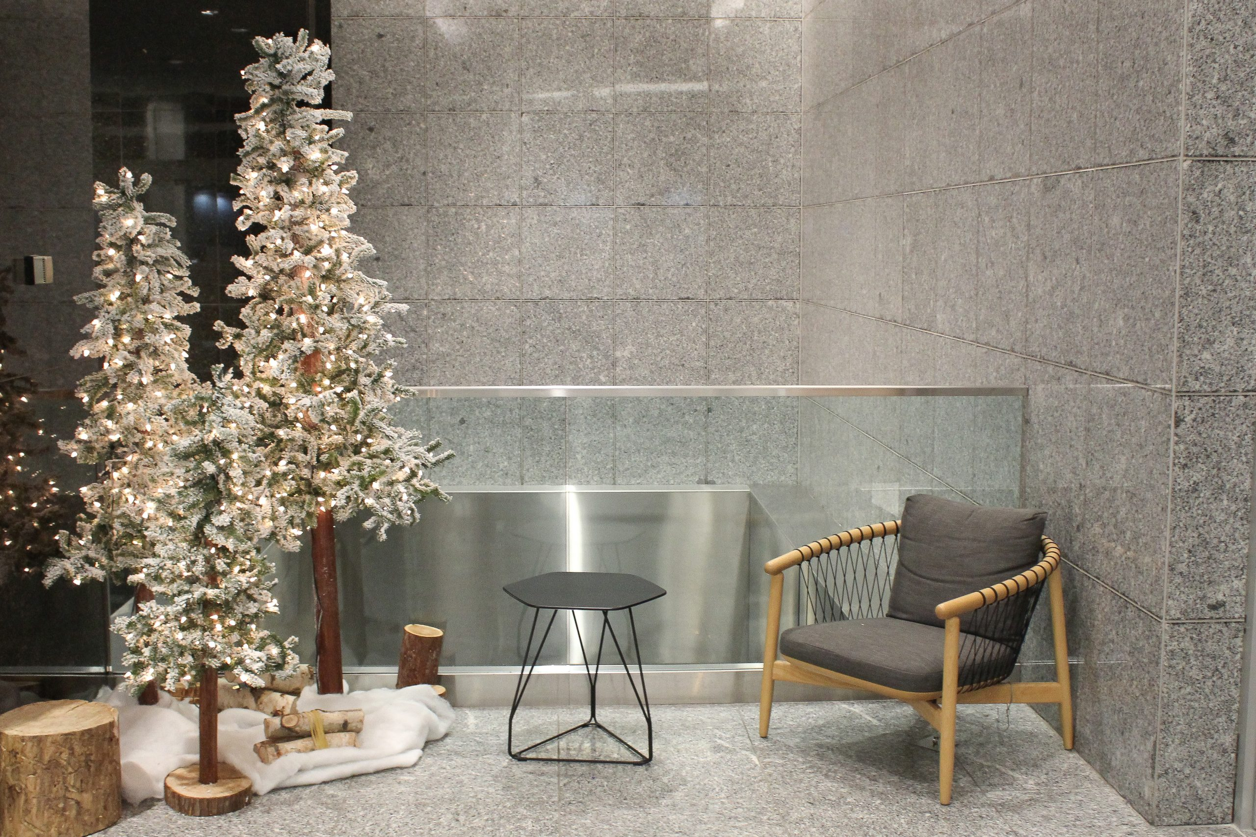 frosted alpine trees in lobby vignette with snow blanket and wood accents