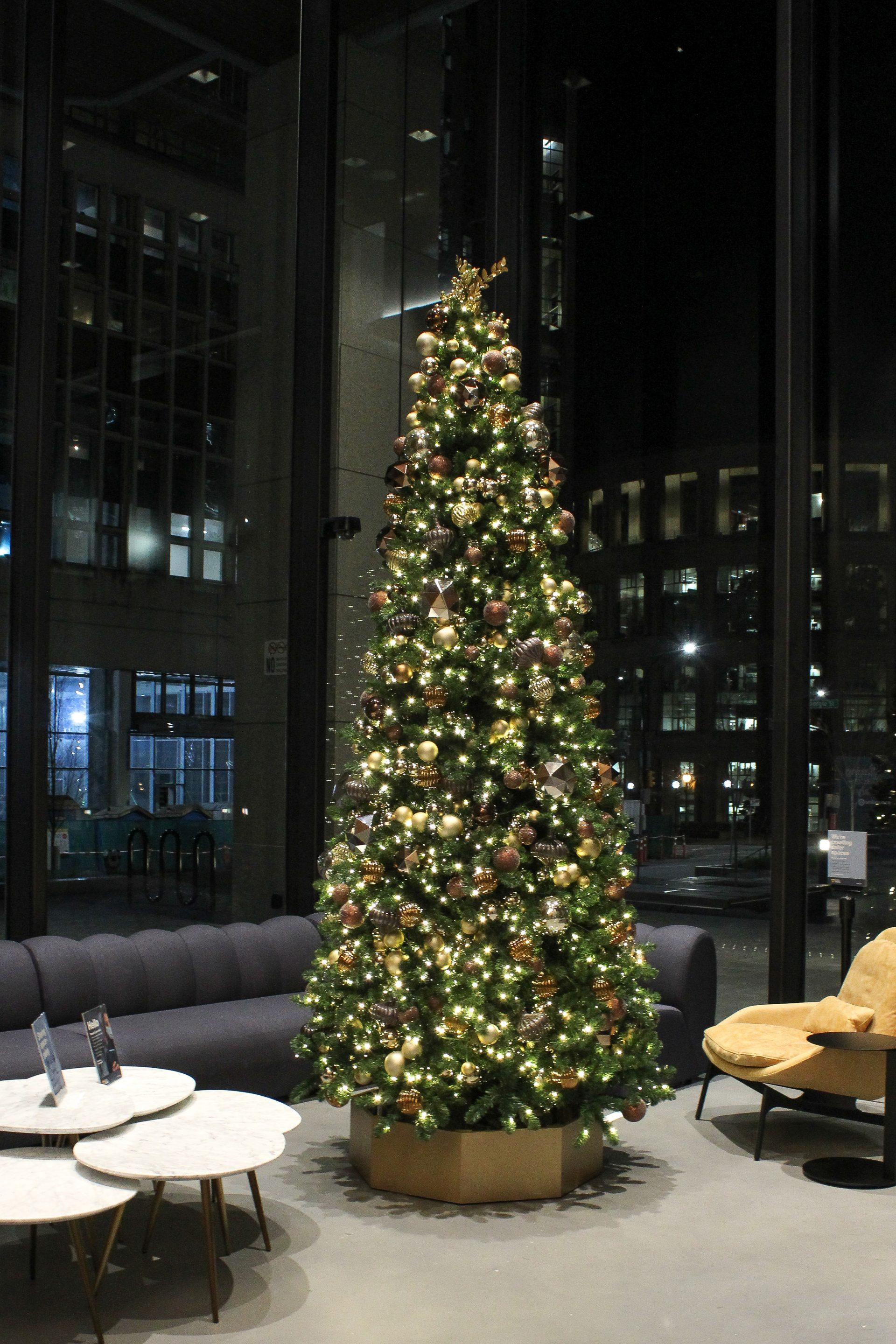 12' tall christmas tree decorated in mixed metallics in commercial office lobby at 401 west georgia