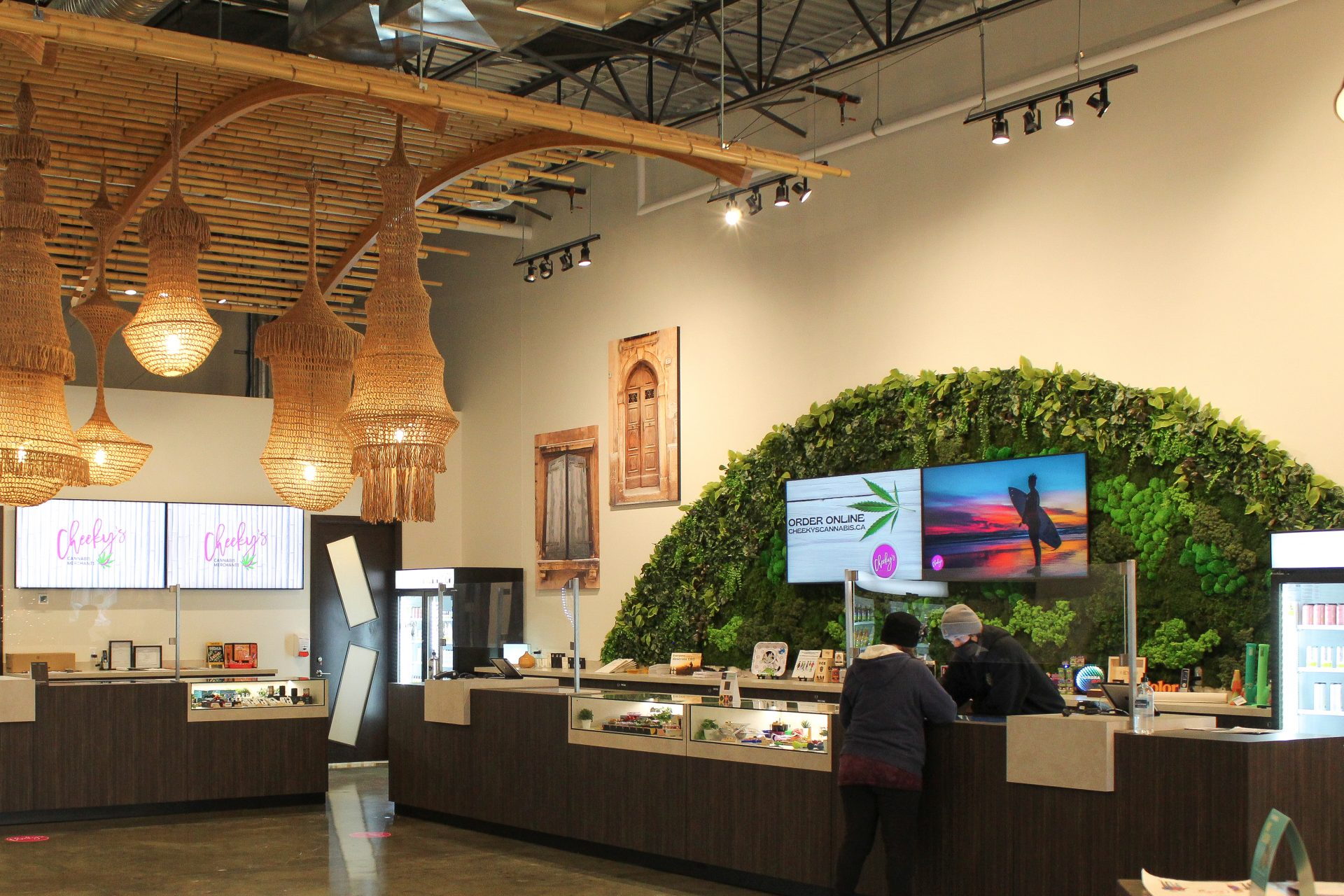 mixed green wall with mixed preserved moss and artificial greenery in wave shape at cannabis dispensary
