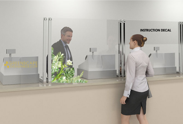male customer service representative standing behind countertop plexiglas panels with three checkout station, assisting a customer