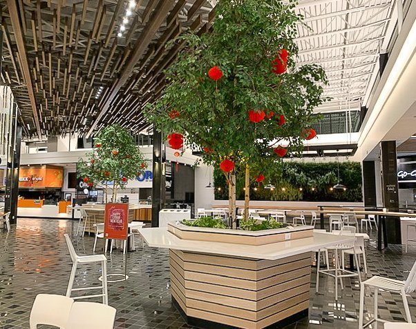 red chinese lanterns hung in permanent artificial birch trees at the city of lougheed food court
