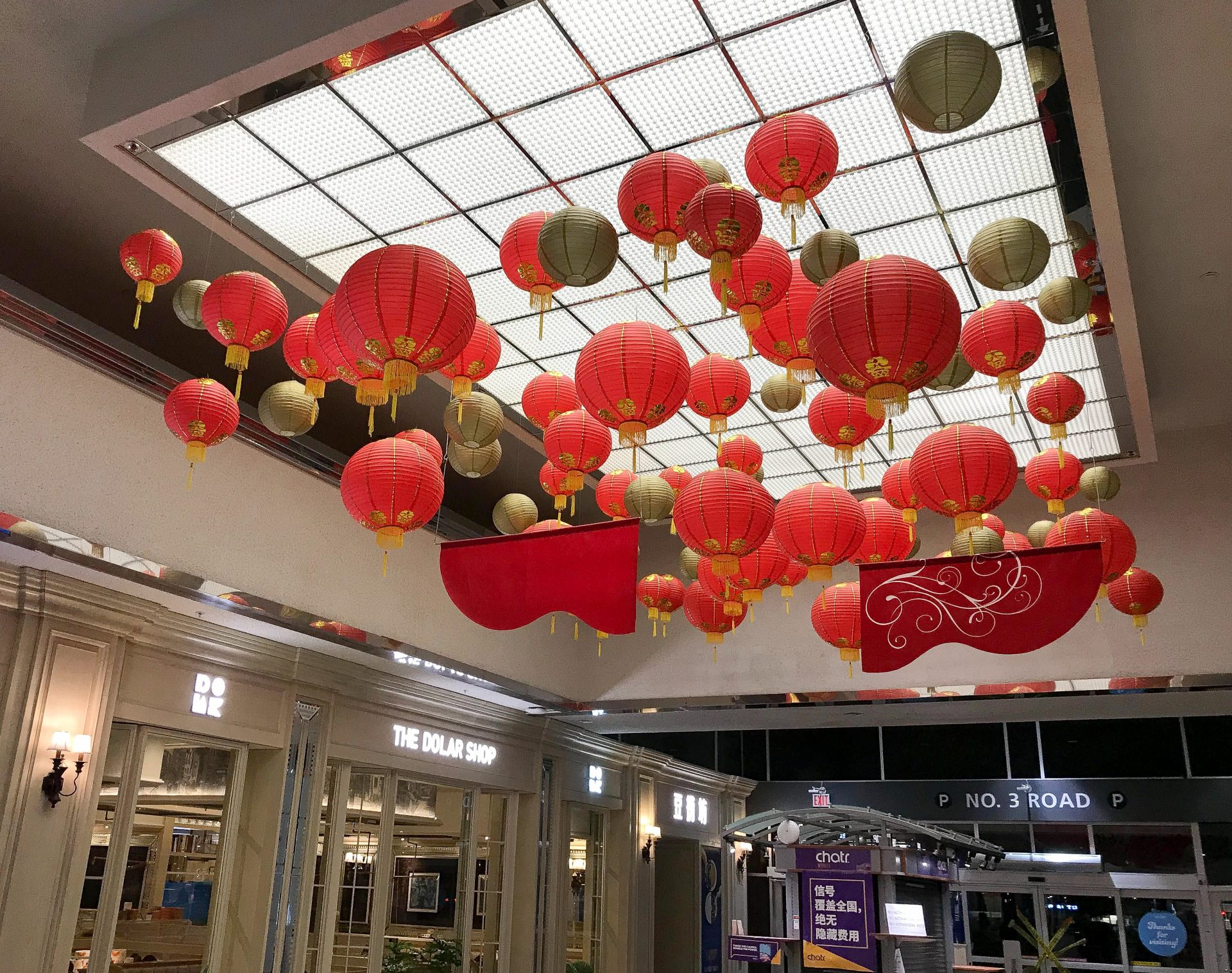 Large cluster of red and gold traditional chinese lanterns for lunar new year at Lansdowne Mall