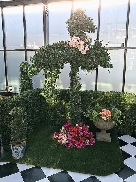 ivy horse topiary with floral accents for art of wonder