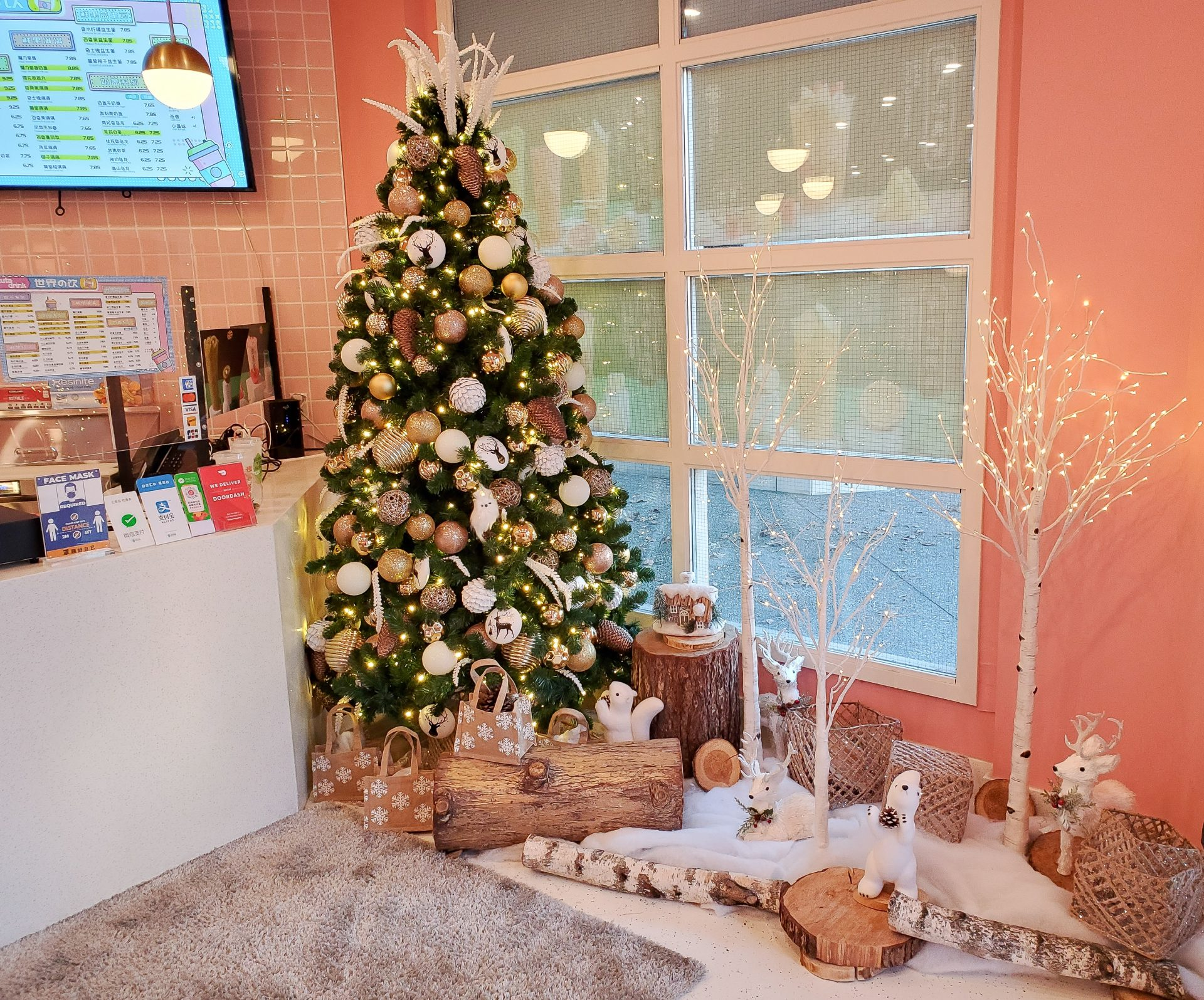 Christmas tree and woodland decor with LED birch trees, snow blanket and wood stumps