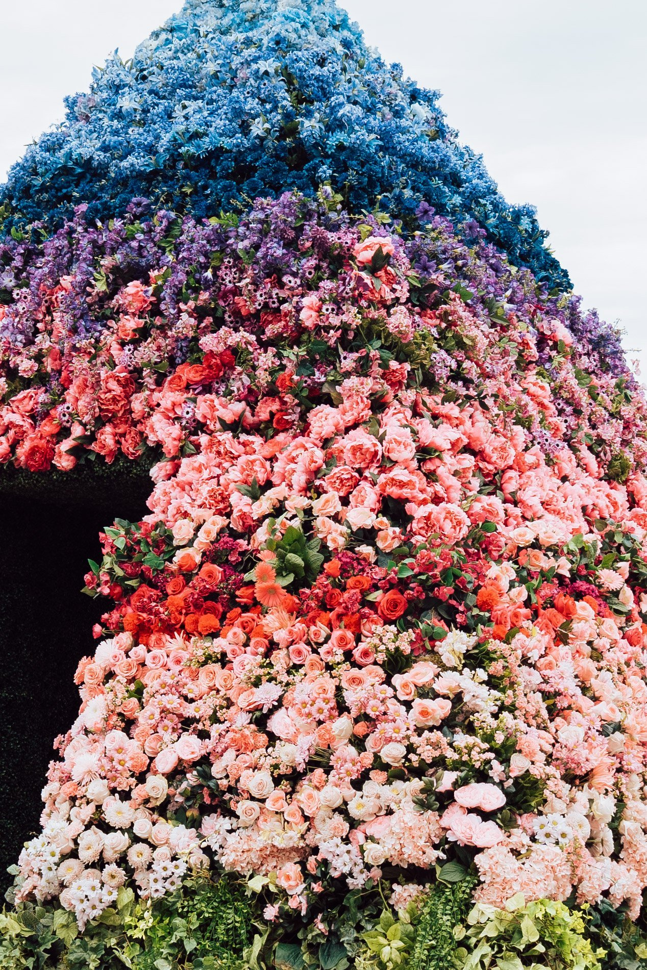close up of entrance of shaw brighter together flower pyramid, ombre flower design on outside of pyramid